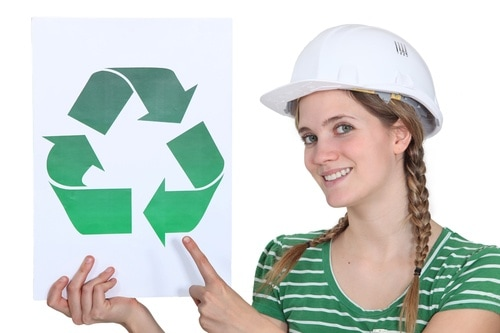 craftswoman all smiles showing recycling sign