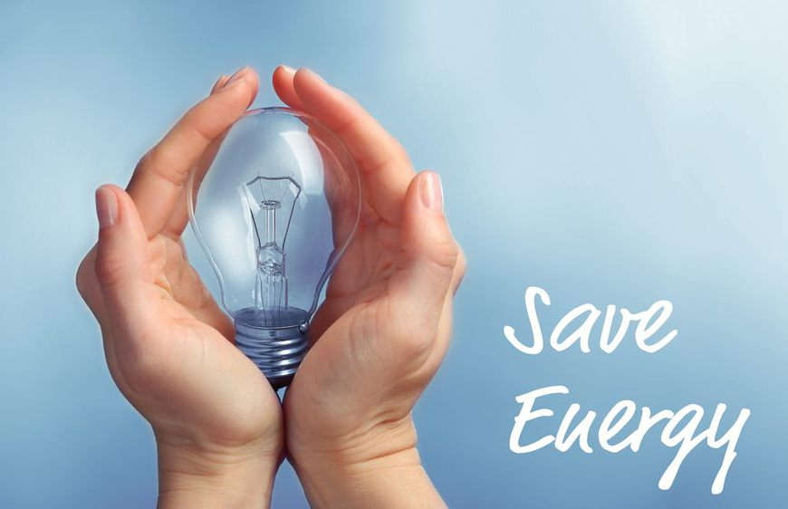 Female hands holding light bulb. Text SAVE ENERGY on blue background