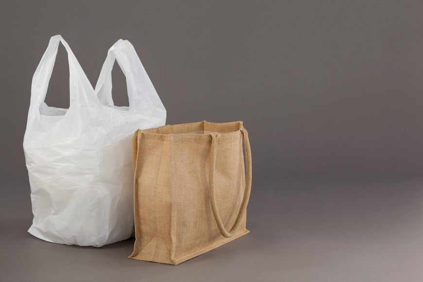 Beige fabric bag and white plastic bag