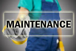 Closeup of construction worker choosing Maintenance button on virtual screen.