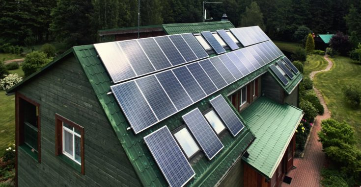 Rustic wooden house with a solar panels on a roof