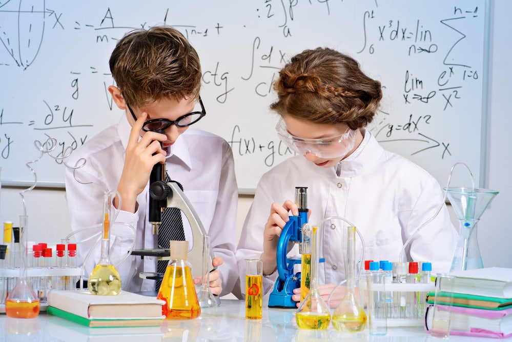 Children doing experiments in the laboratory. Science and education.