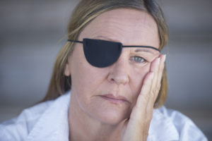 One eye blind old woman with patch