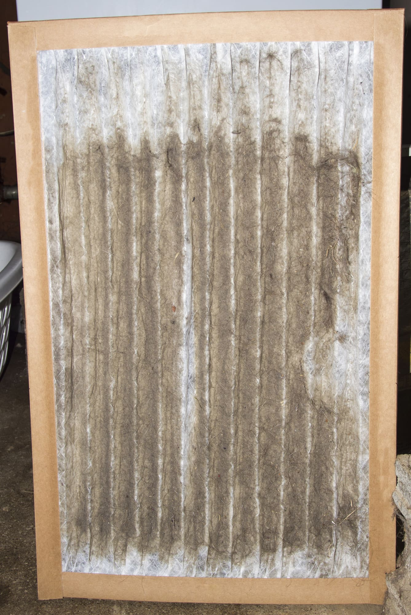 Front View of A Dirty Furnace Filter Taken Out Of A Customer's Furnace