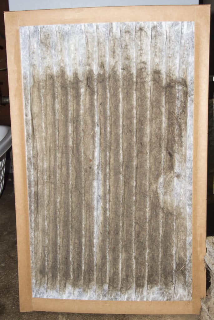 Front view of a dirty furnace filter taken out