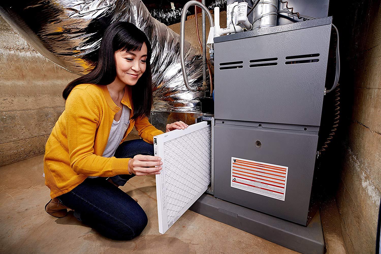 Woman replacing the filter